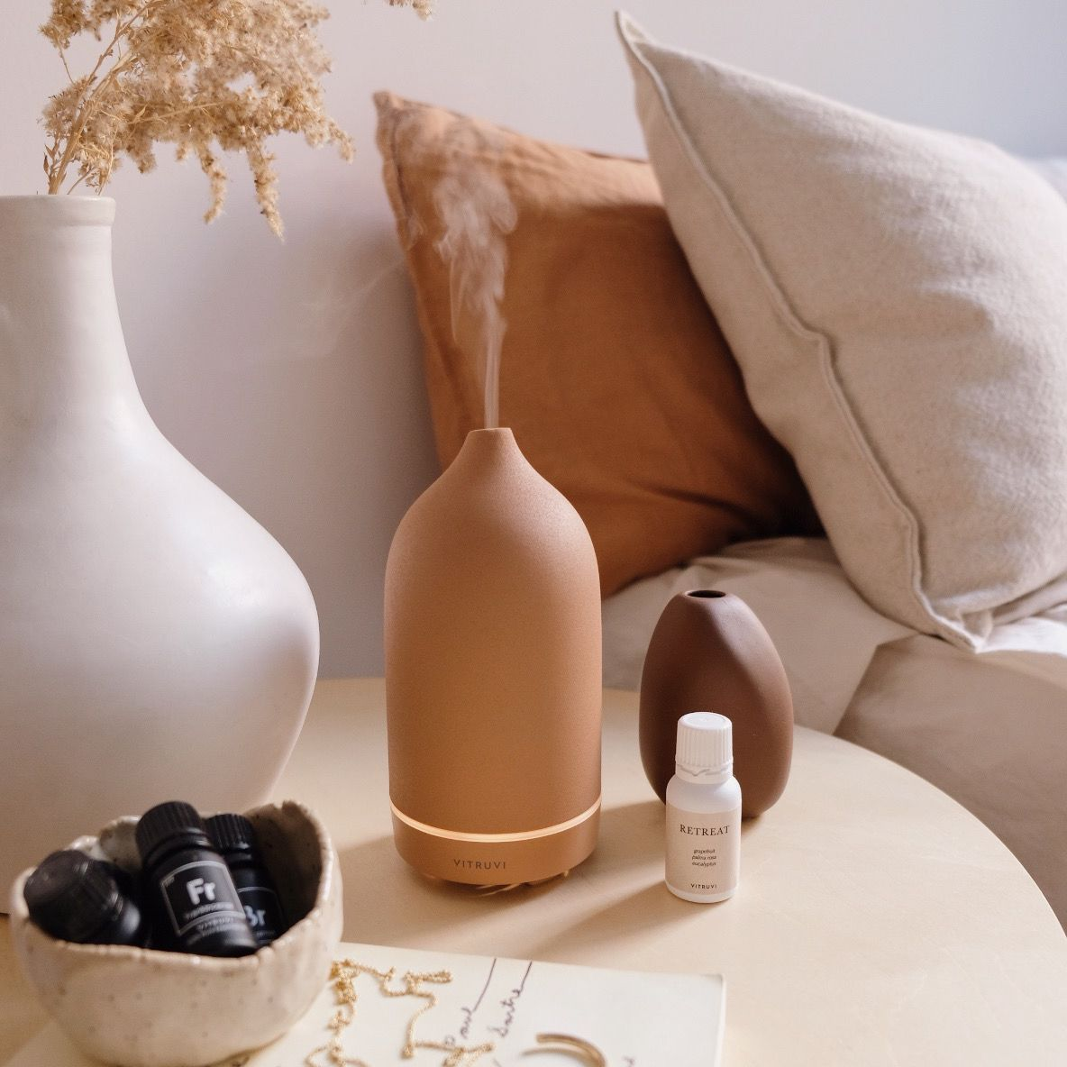 terracotta essential oil diffuser on bedside table