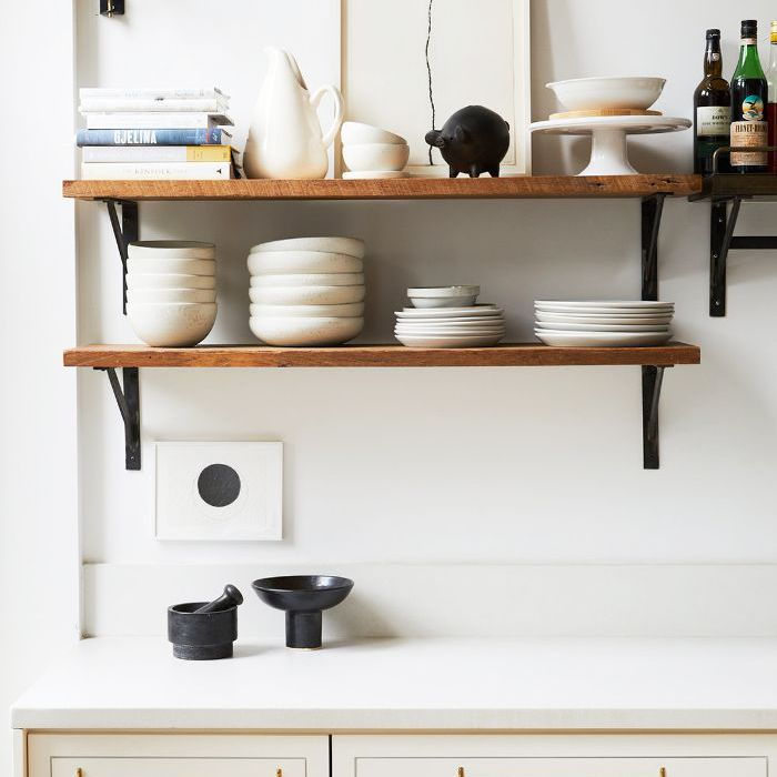 Best Apartment Lighting Ideas: A black mounted lamp in the kitchen for task lighting