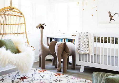 nursery with a bucket swing
