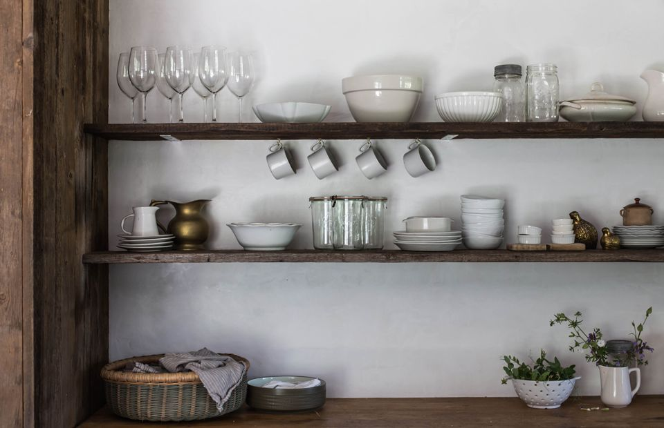 Kitchen shelves lined with gray and white essentials