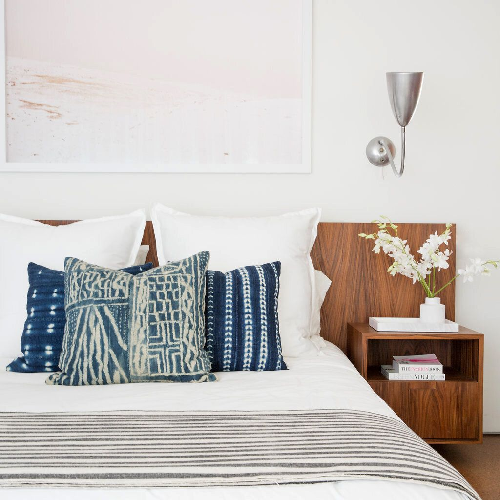 White bedroom with navy pillows