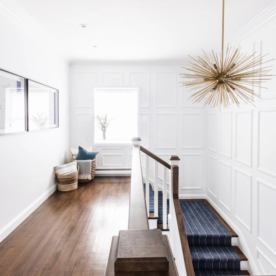 Hallway with white wood panneling