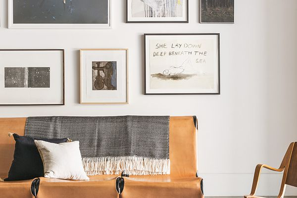 A large gallery wall in a living room