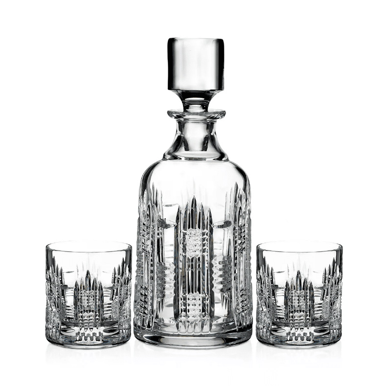 A crystal decanter with a set of two matching old-fashioned glasses.