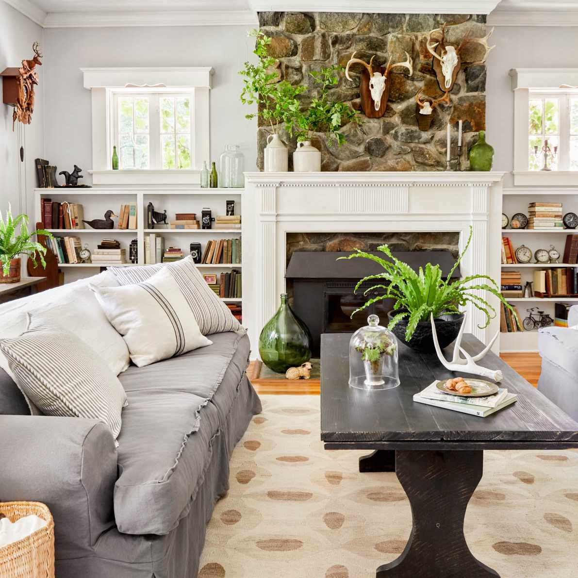 white small bookcases that are in line with fireplace