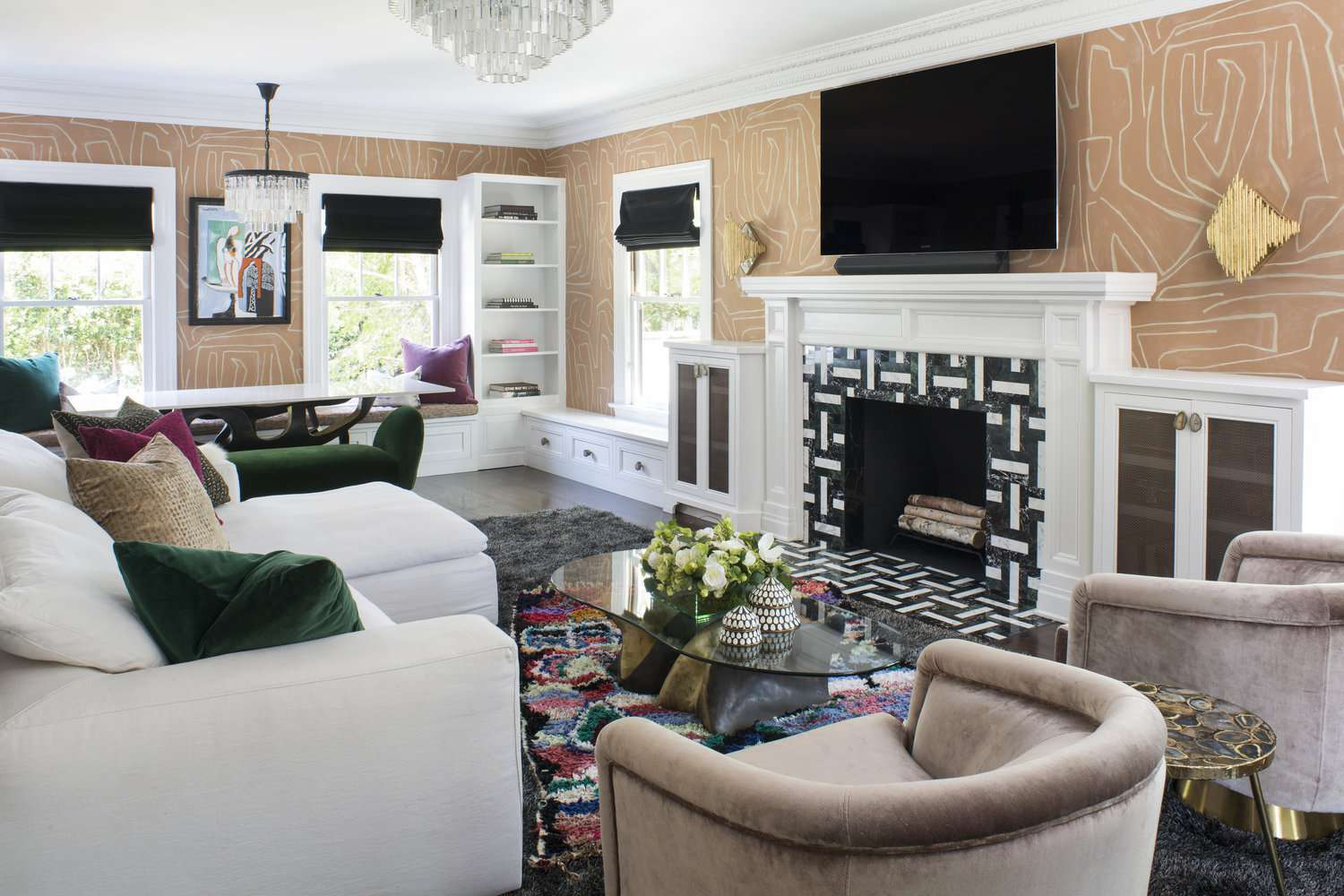 Bold living room with coral wallpaper.