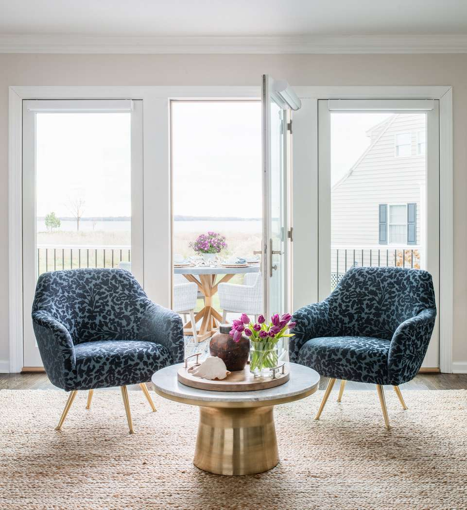 Liz Mearns home tour - seating area with floral chairs