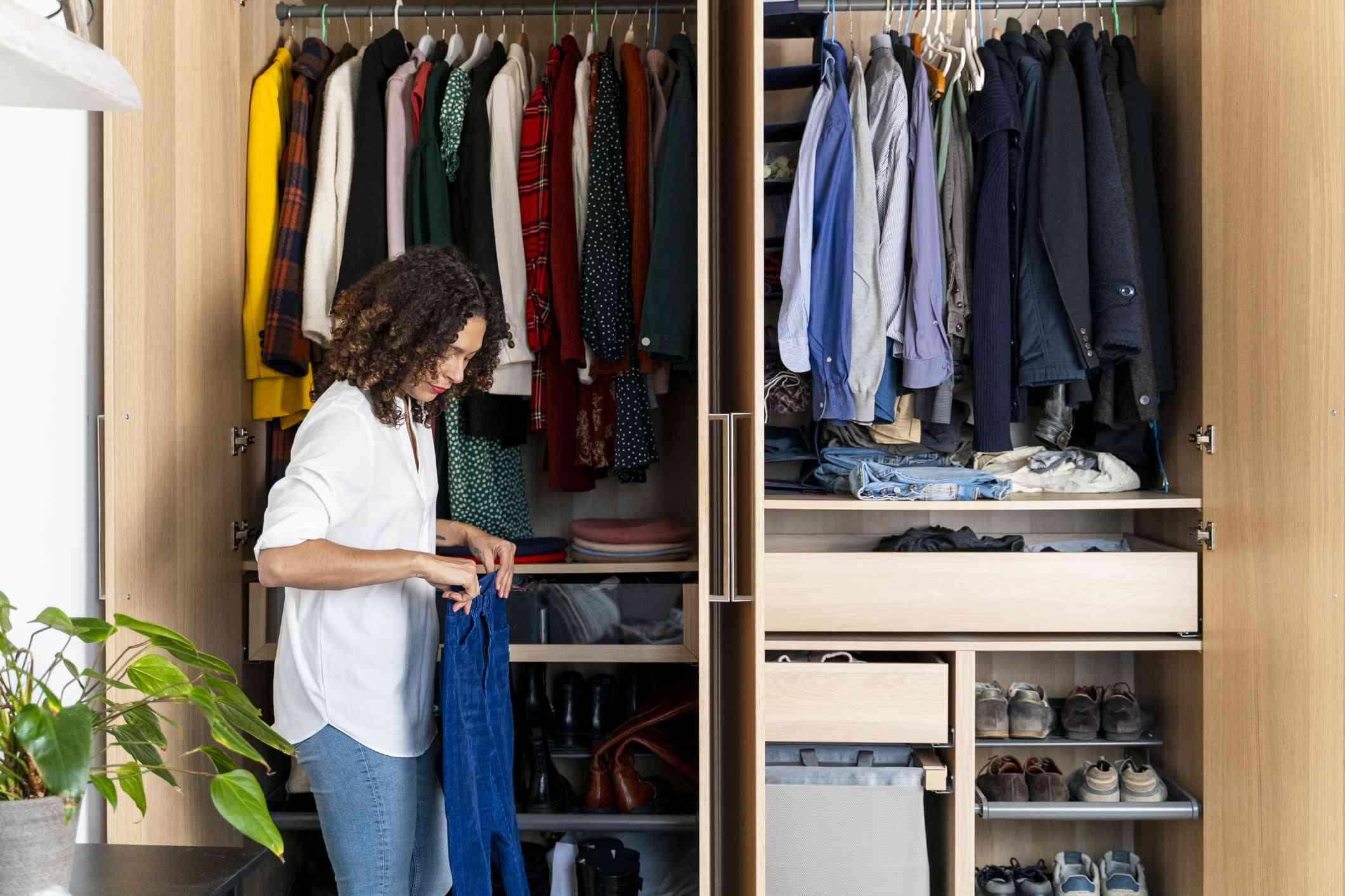 Woman organizes closet