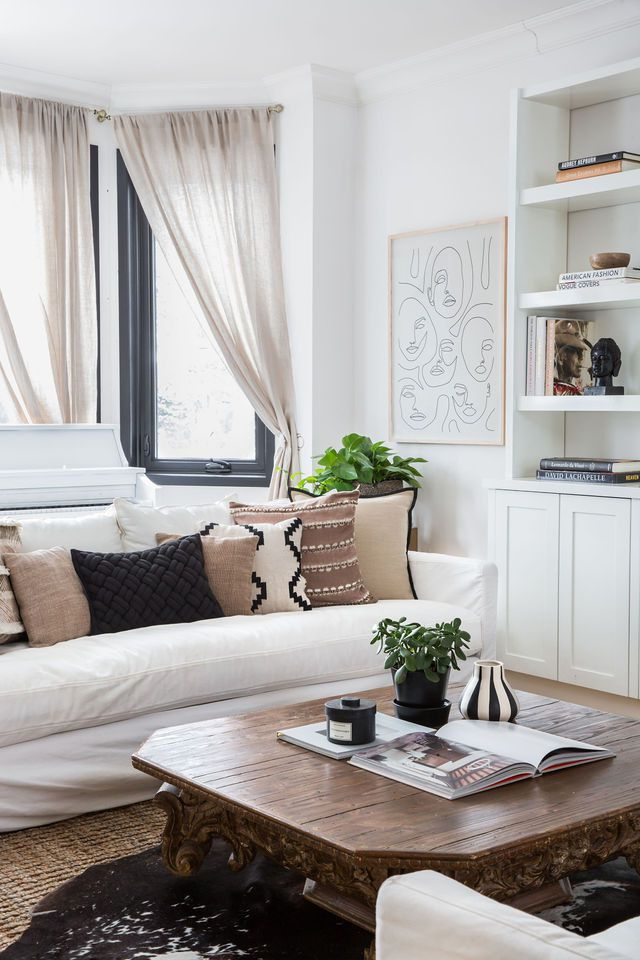 Cozy neutral living room with a white, tan, and black color palette.