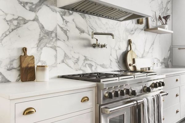 Kitchen with marble backsplash and gold accents