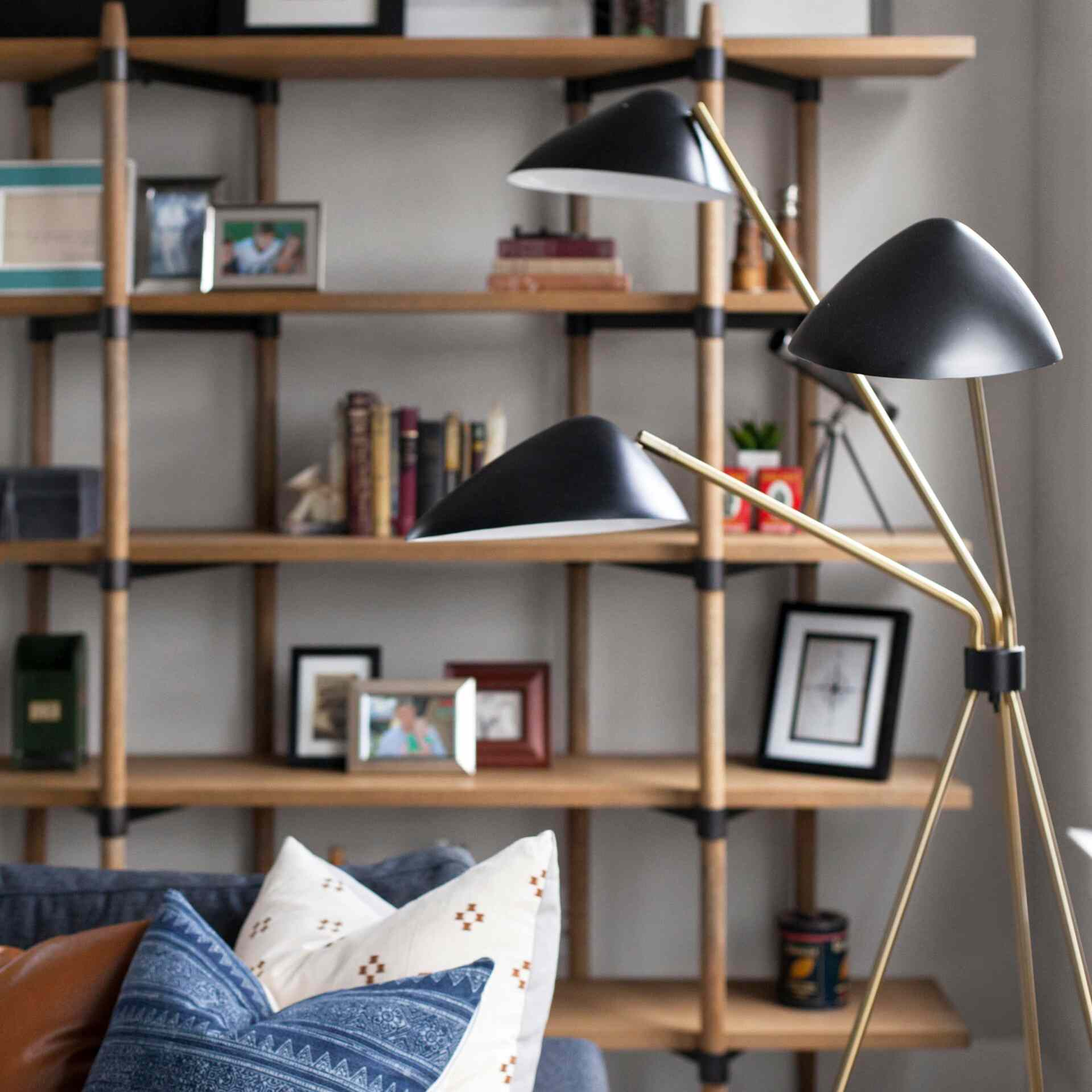 Living room with vertical styled bookshelf and Mid-Century Modern lamp