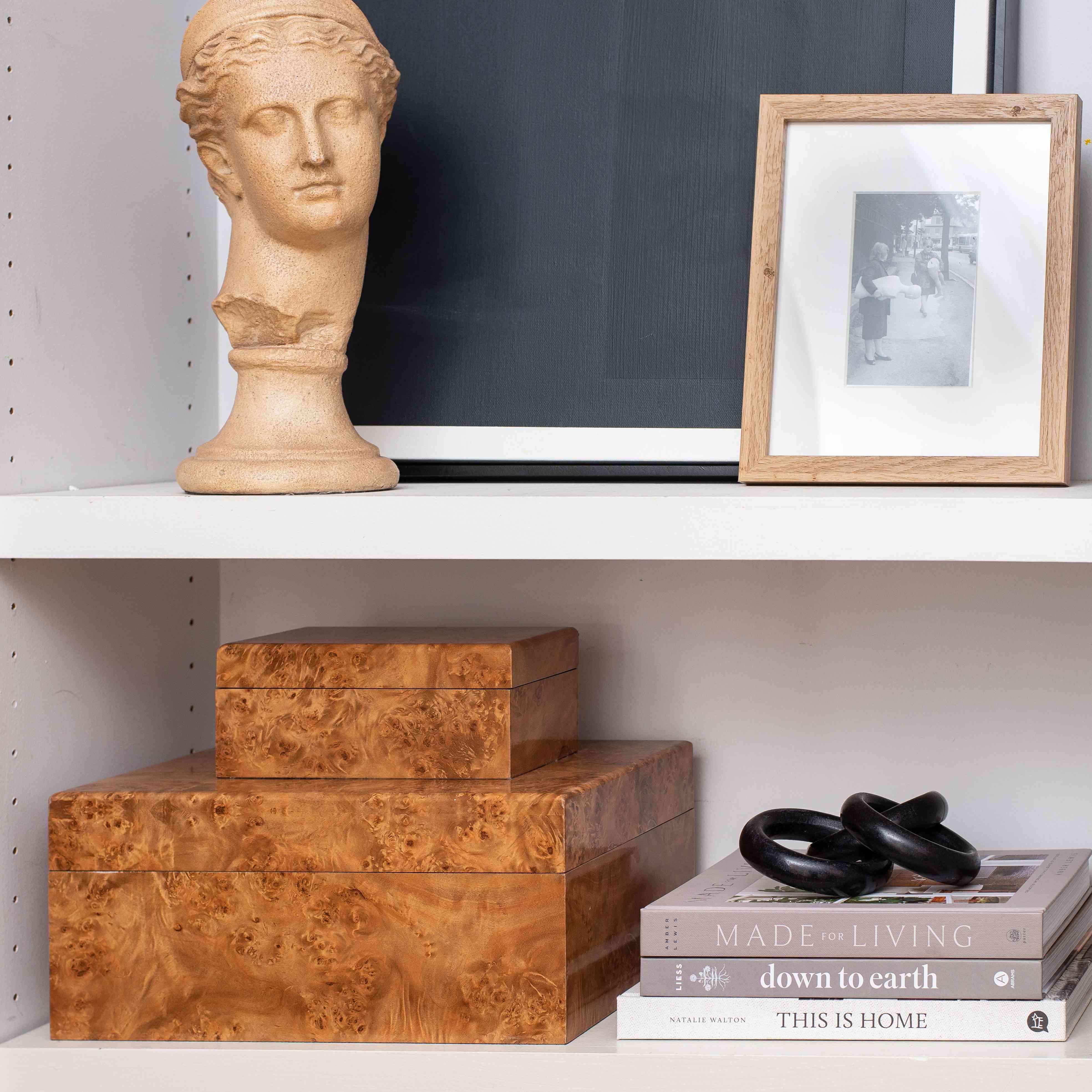 Burl wood boxes on top of shelf.