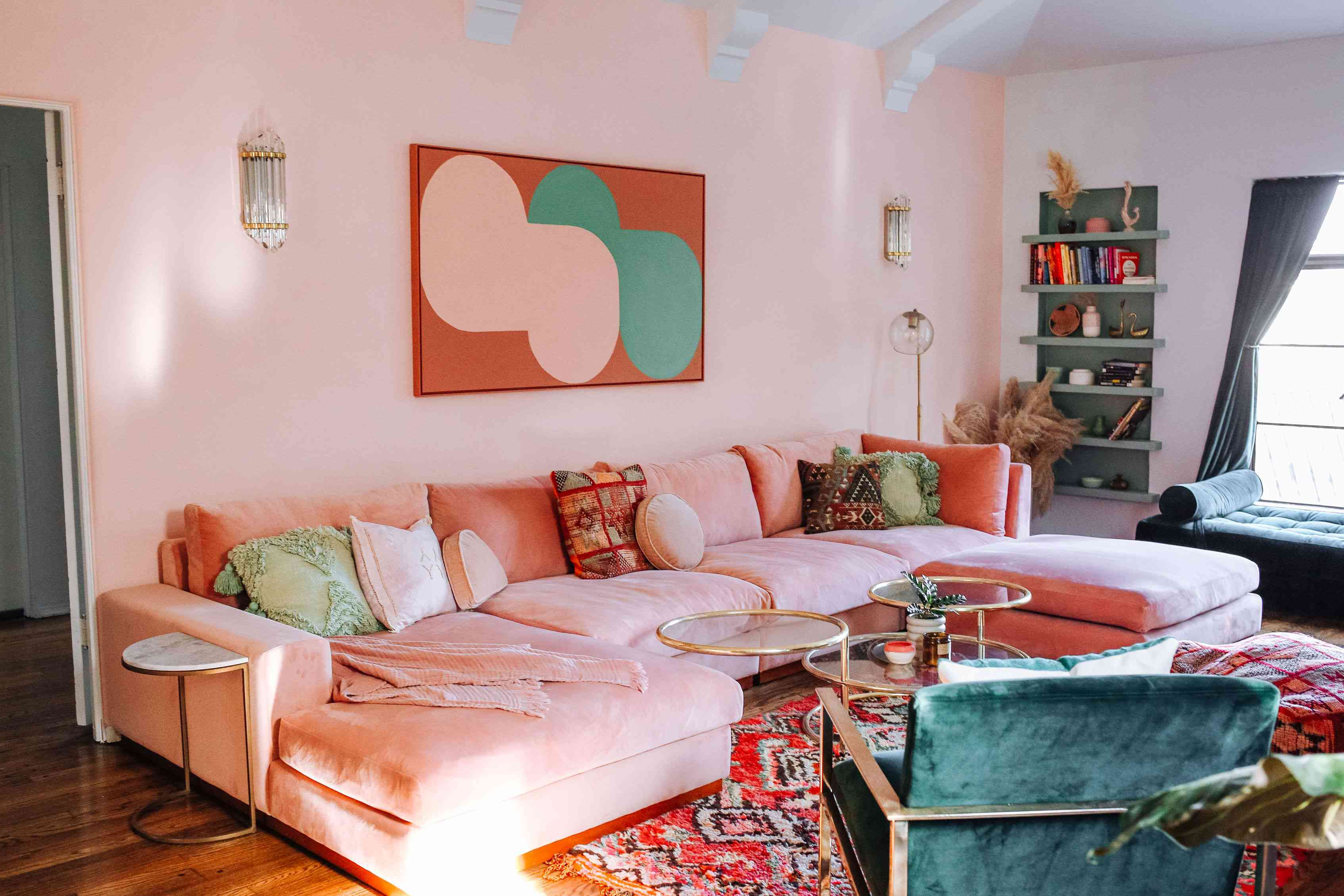 best living room ideas - light pink couch with matching pink walls