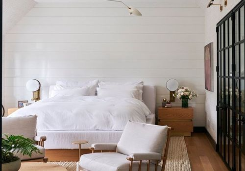 Bedroom with a chair and light fixture