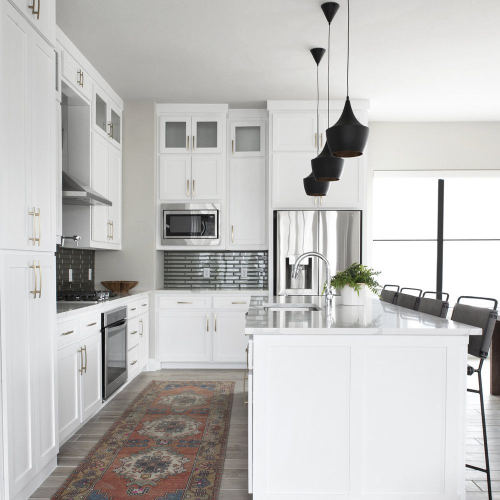 kitchen with rug next to island