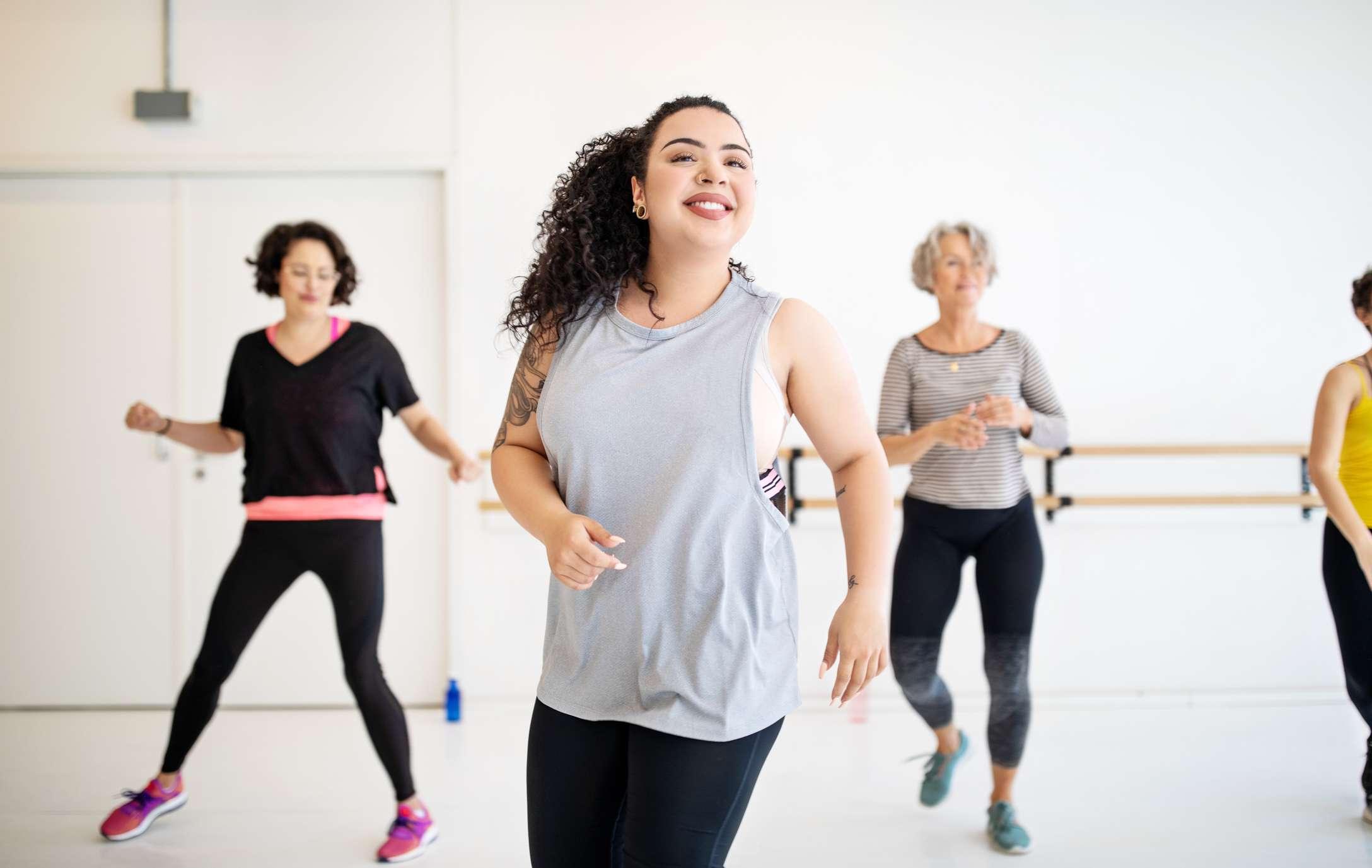 Women move in dance class