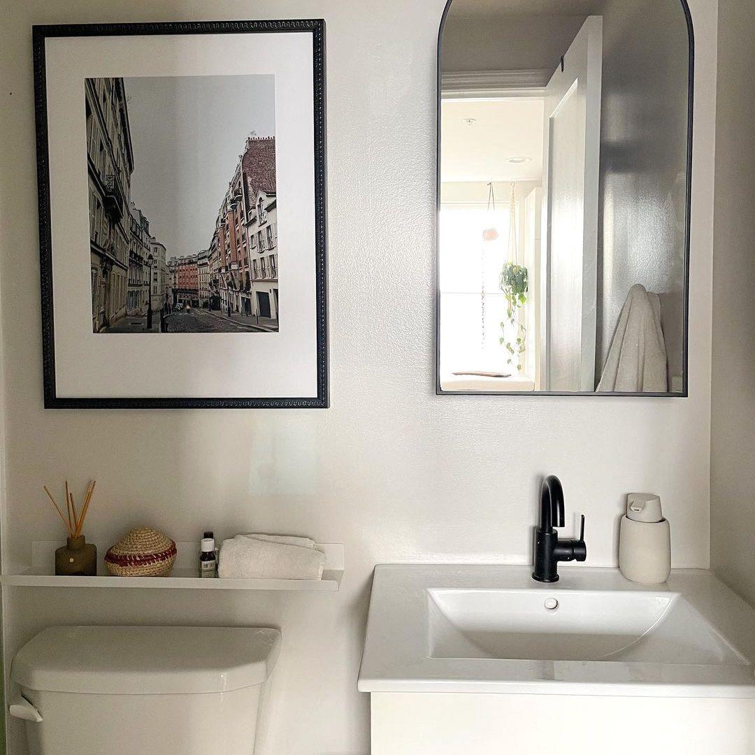 White, black, and wood bathroom