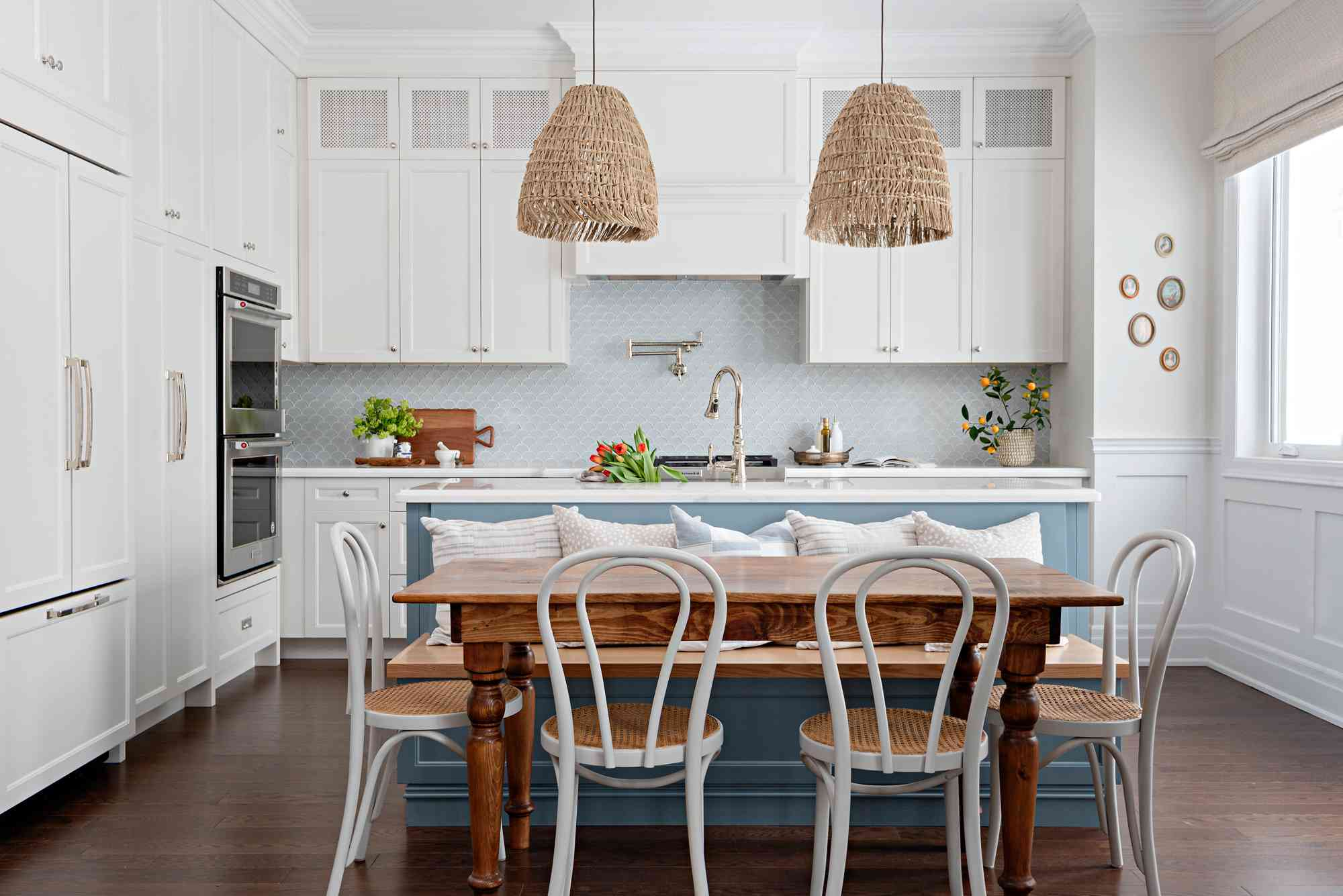 how to design sustainably - white kitchen with vintage dining table and chairs
