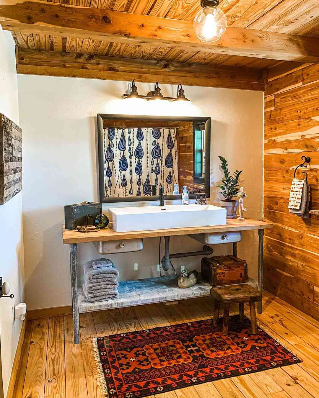 Rustic bathroom with wooden ceiling