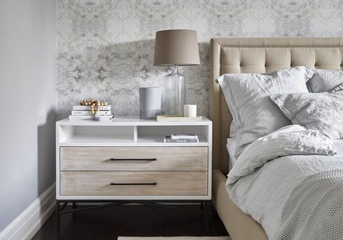 Neutral bedroom with organized nightstand.