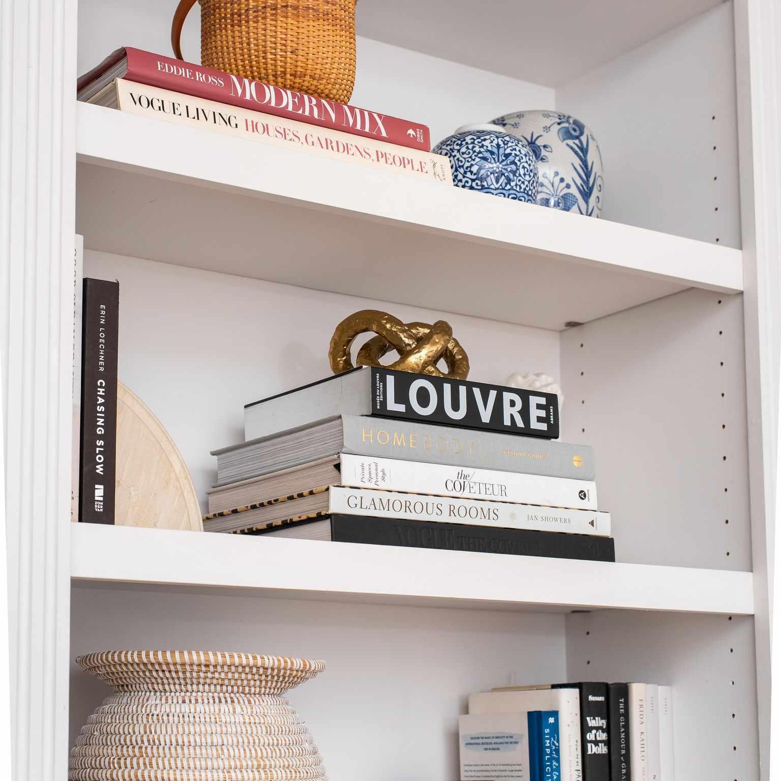 Bookshelf with wicker basket.