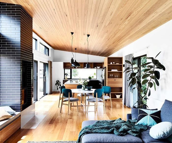 Furniture is spaced a few feet apart to define dining area and living space