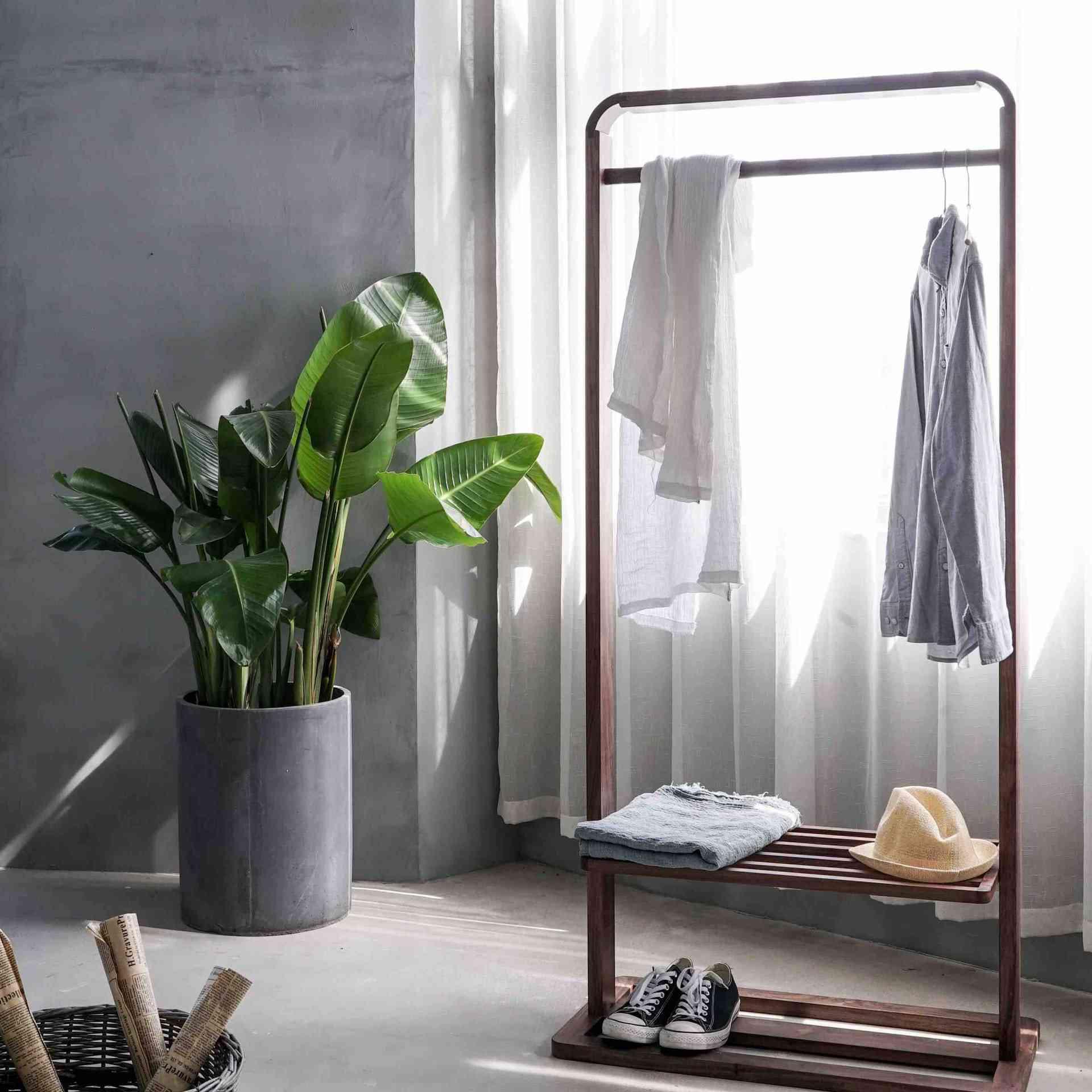 minimalist room with clothing rack