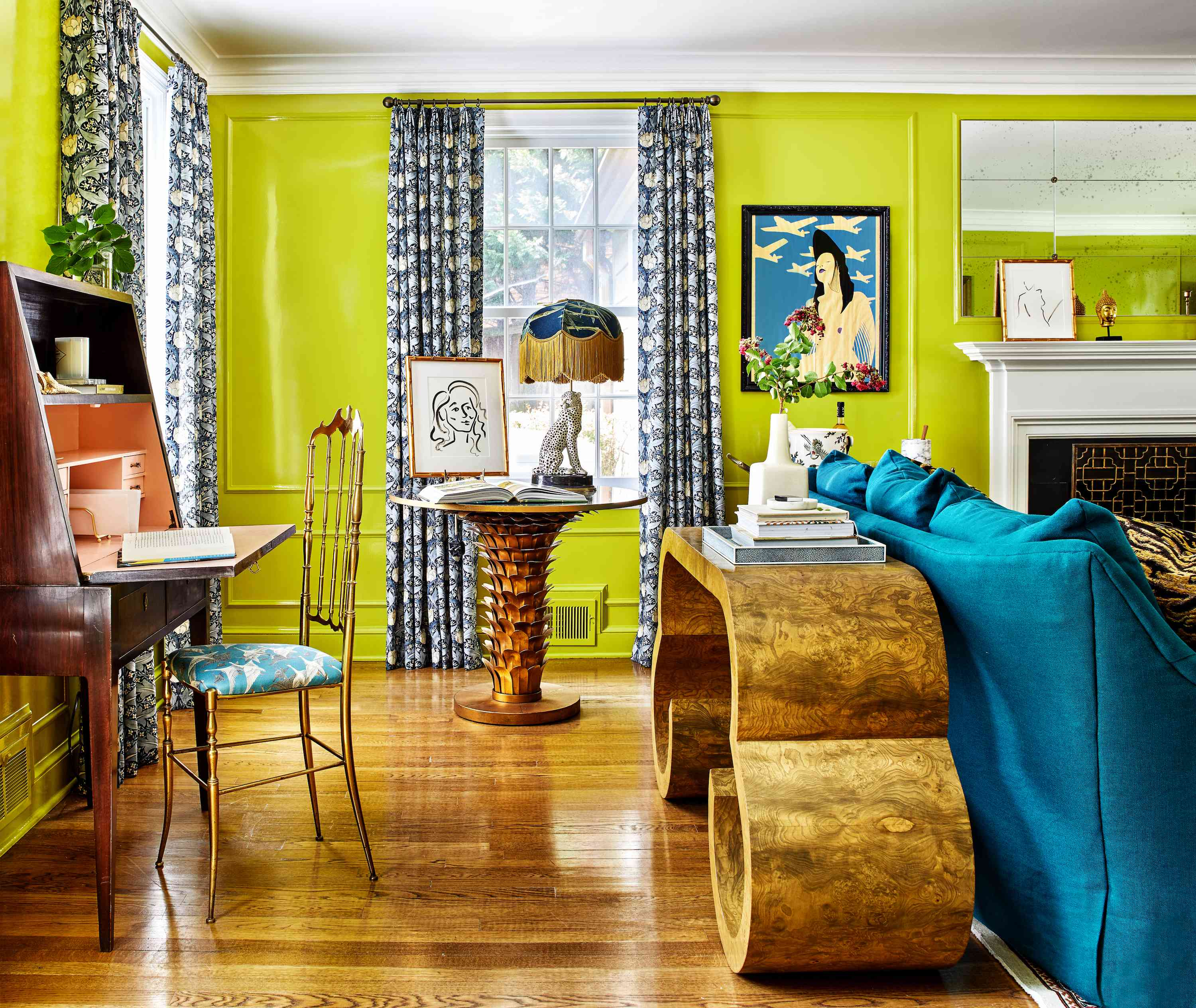 Chartreuse living room with drapes and burl wood table.