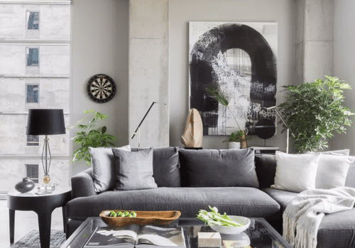Living room with concrete walls, large-scale art on wall