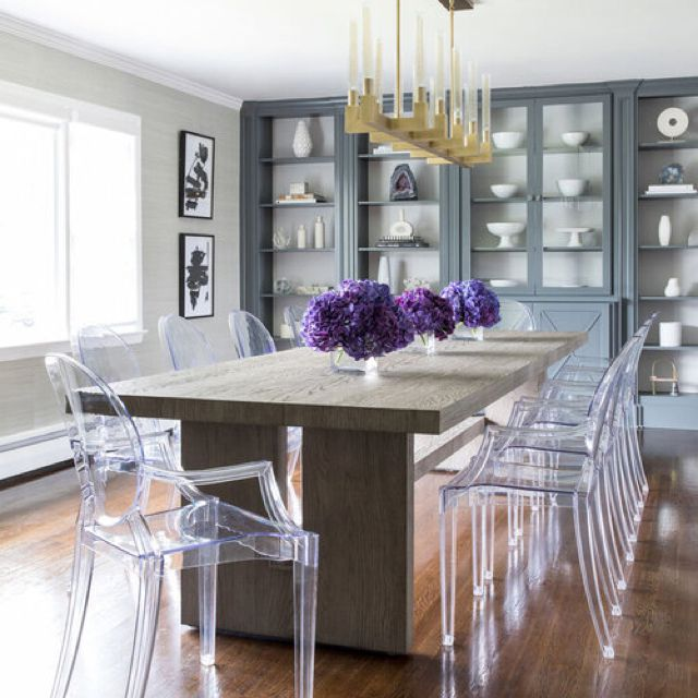 Sleek gray dining room with clear ghost chairs