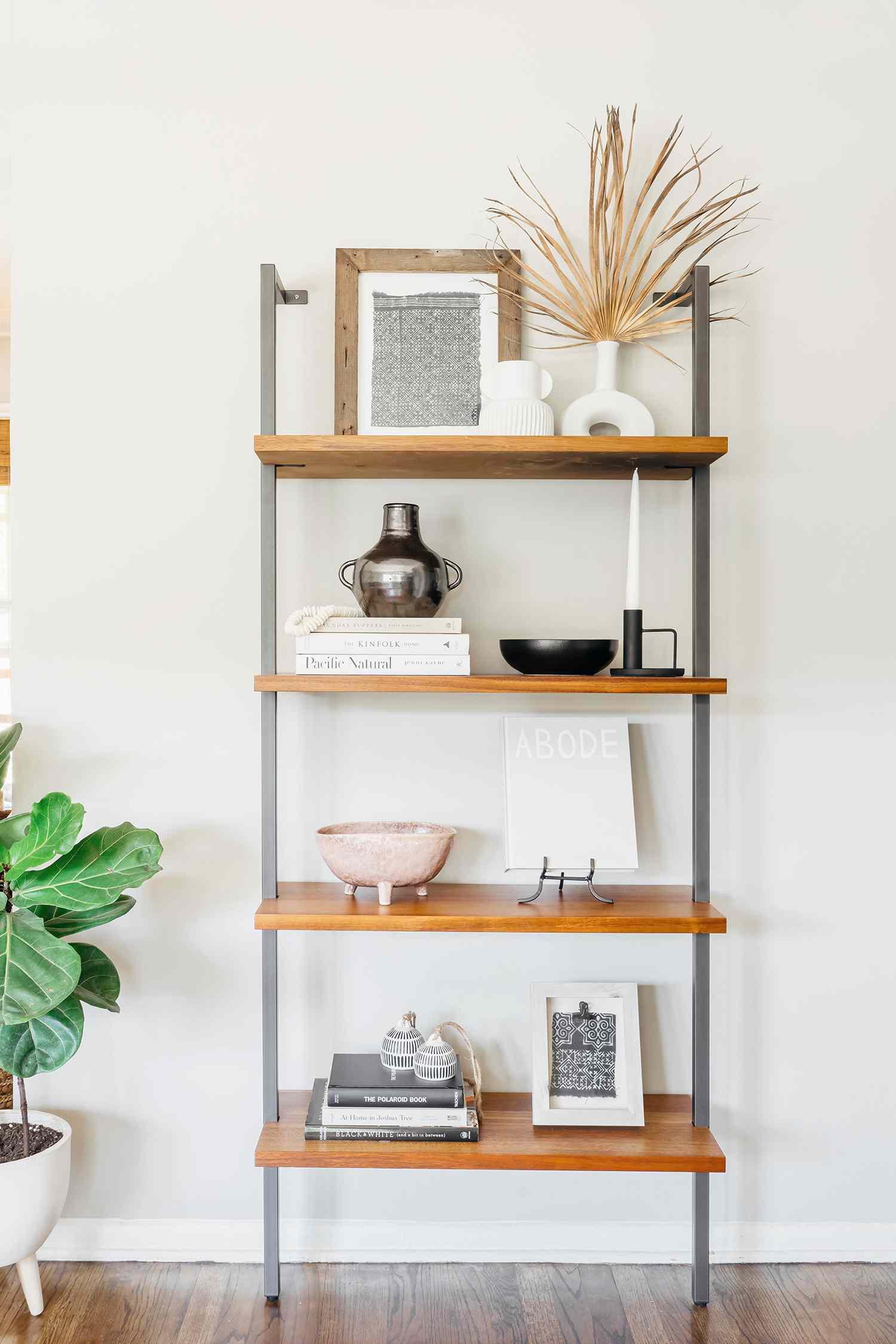 alisha agrellas home tour - bookshelf in living room