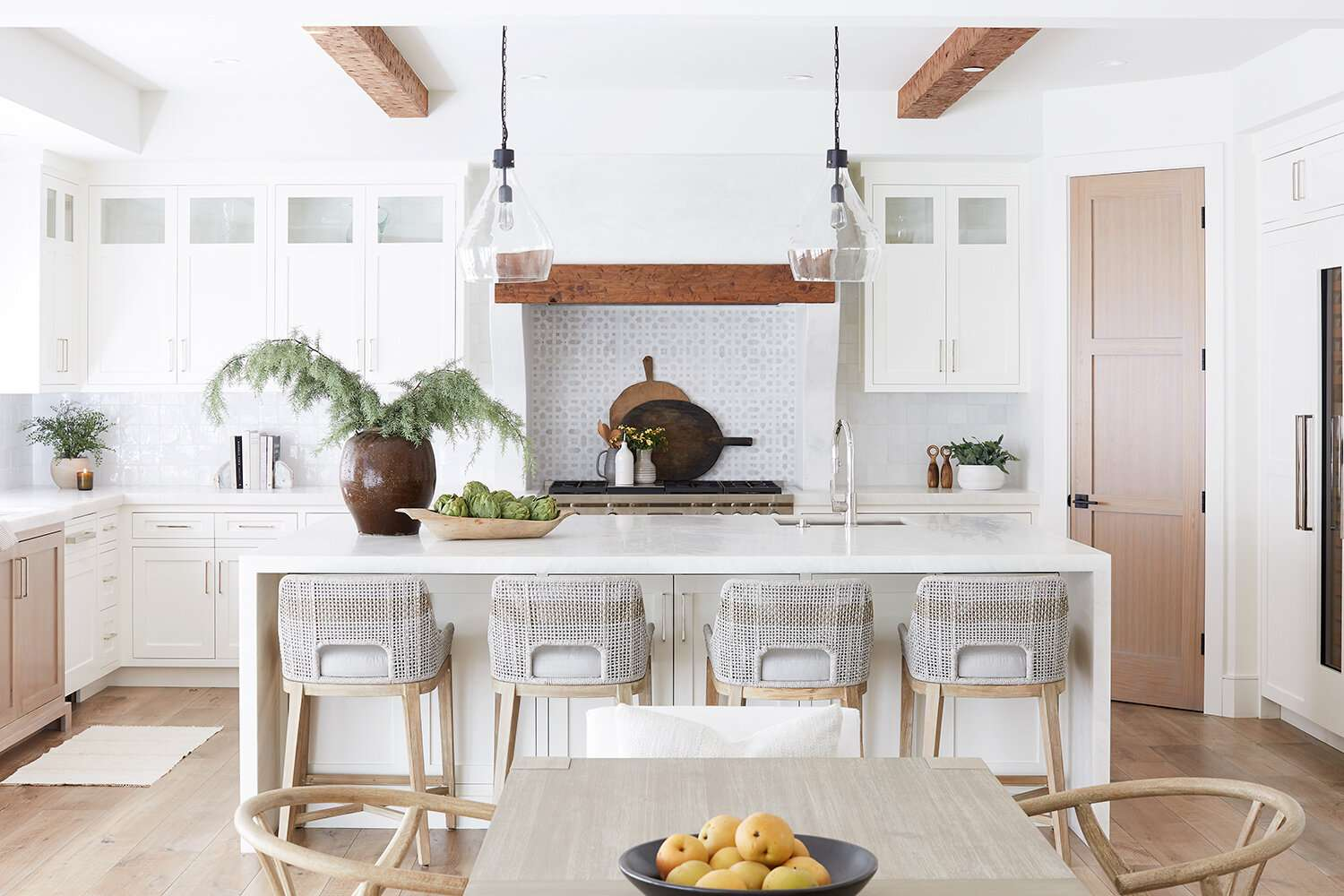 A kitchen lined with two kinds of tiles: classic white tiles and light gray printed ones
