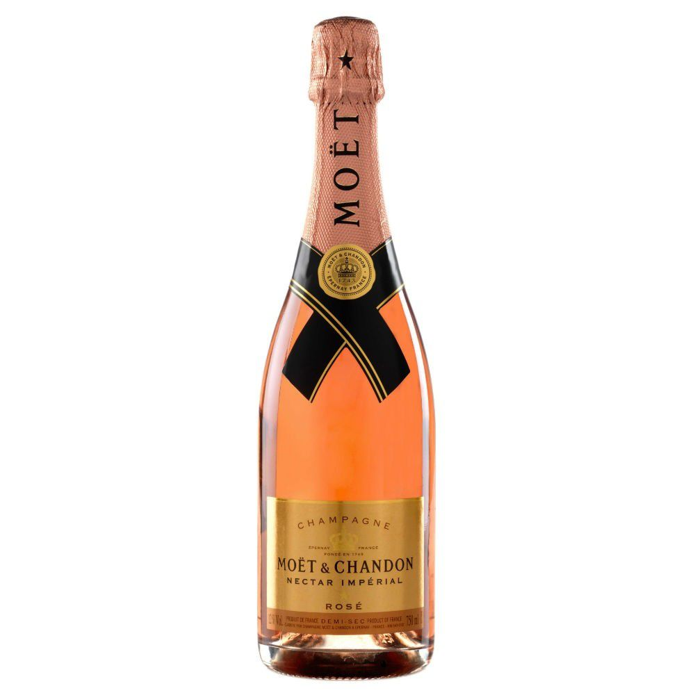 Rose-hued champagne with a gold label on the bottle.