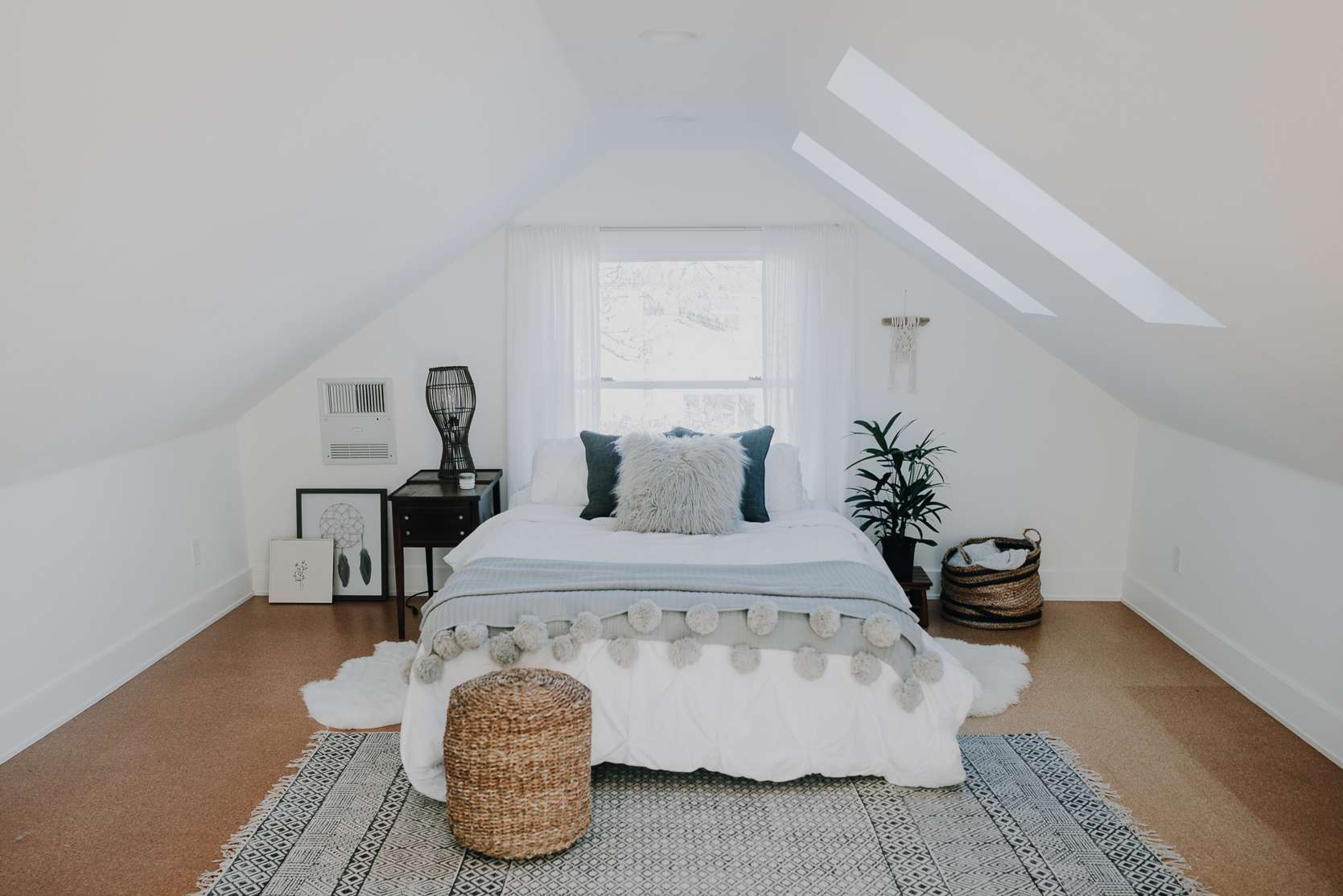 Boho-inspired bedroom with fringed throw blanket