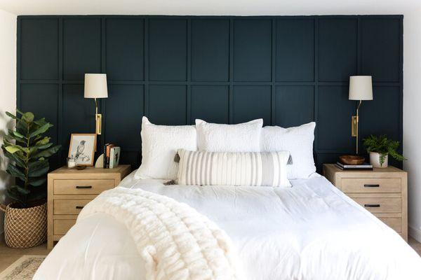 White bedding against a deep blue wall
