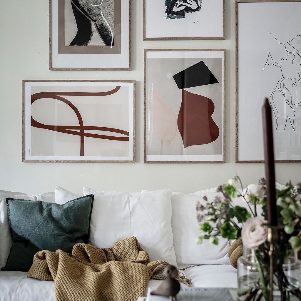 Living room with gallery wall above couch