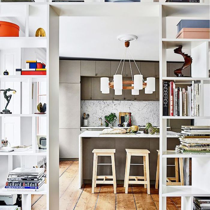 Open-ended bookcases also act as walls in an open living space