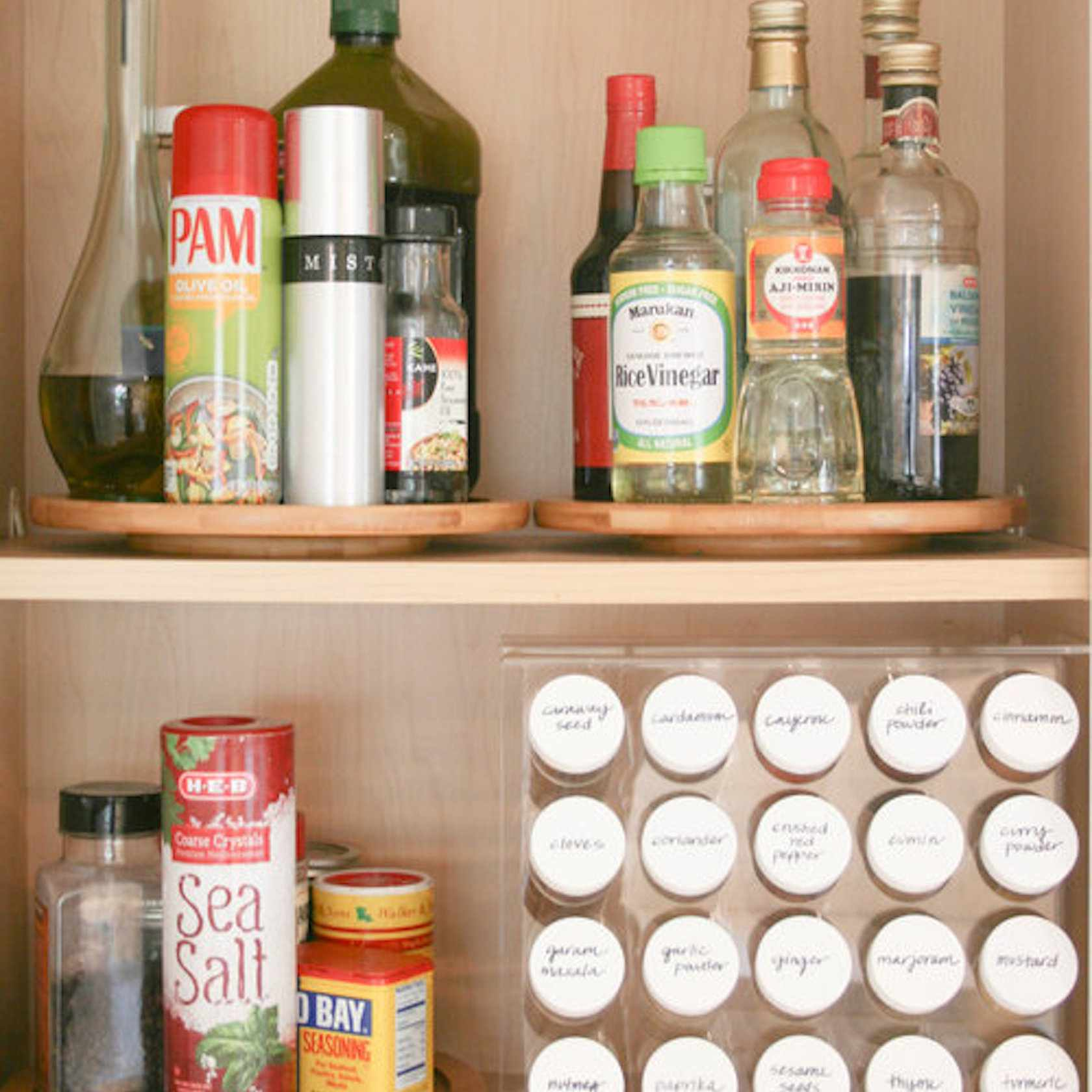 Organized pantry with spice rack.