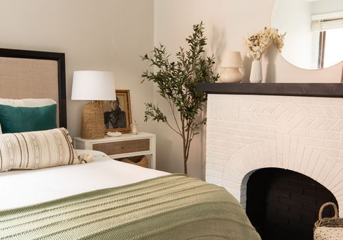 Bedroom with a fireplace mantel