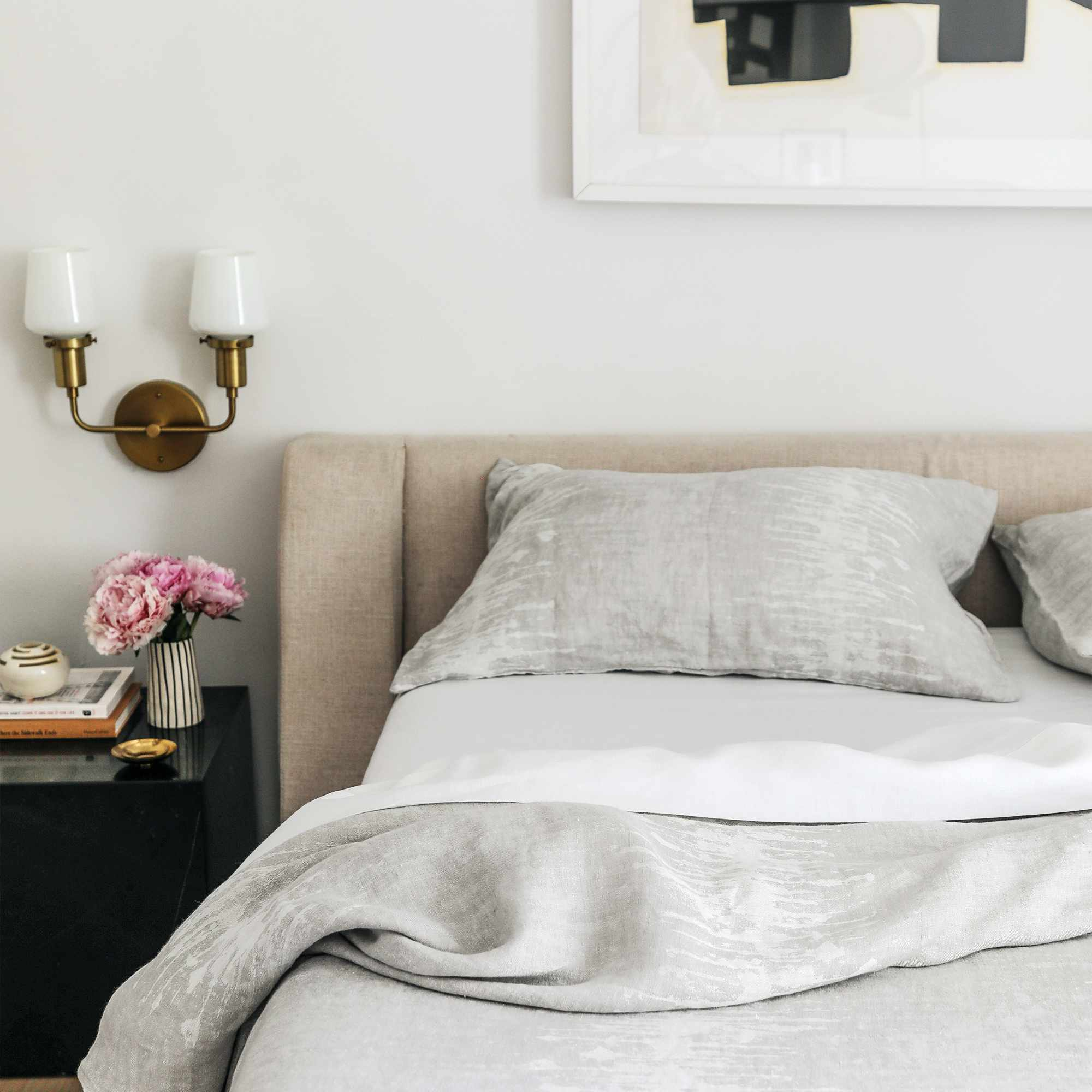 Neutral bed with cozy linen bedding