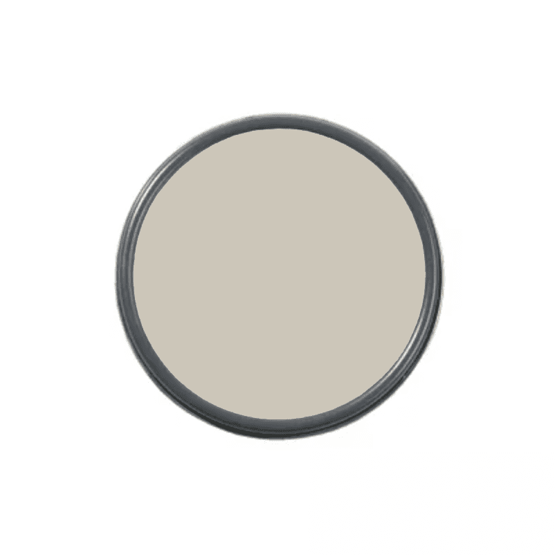 An overhead shot of a paint can with taupe paint in it