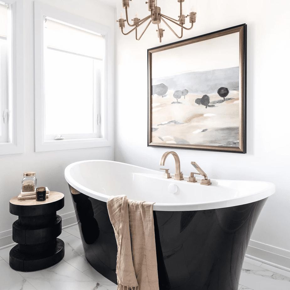 A black bathtub in a white bathroom