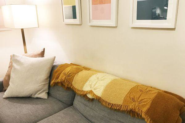 how to mix old and new decor - handknit blanket on sofa