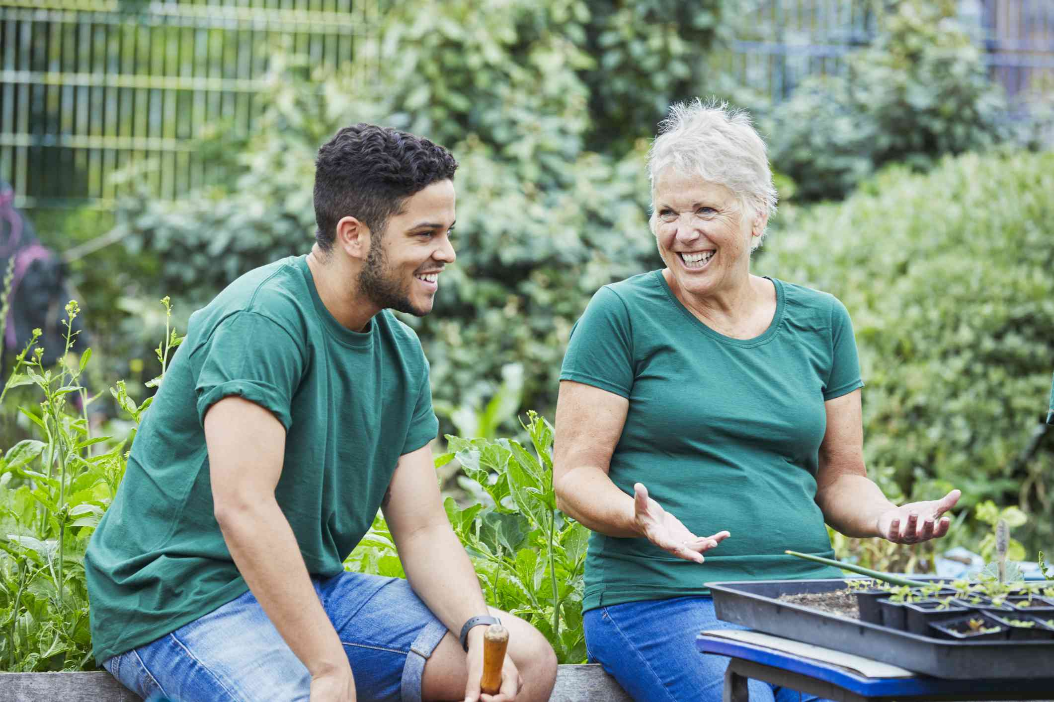 Man and woman laugh together in garden