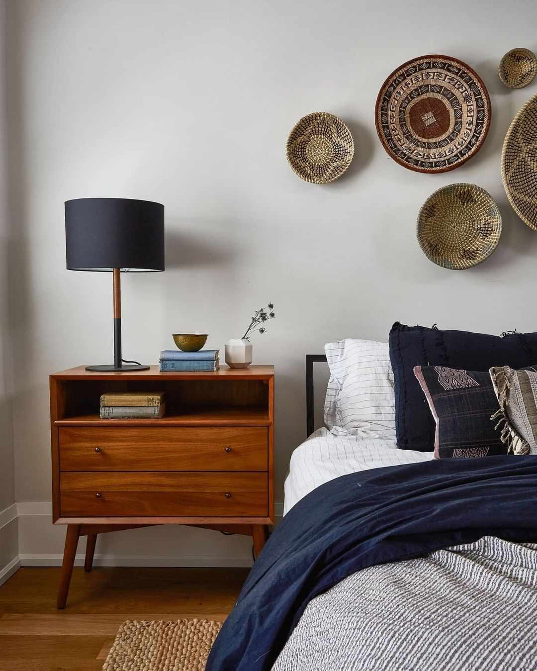 Bed with a wooden nightstand
