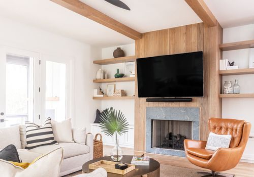Neutral living room with tan leather armchair.