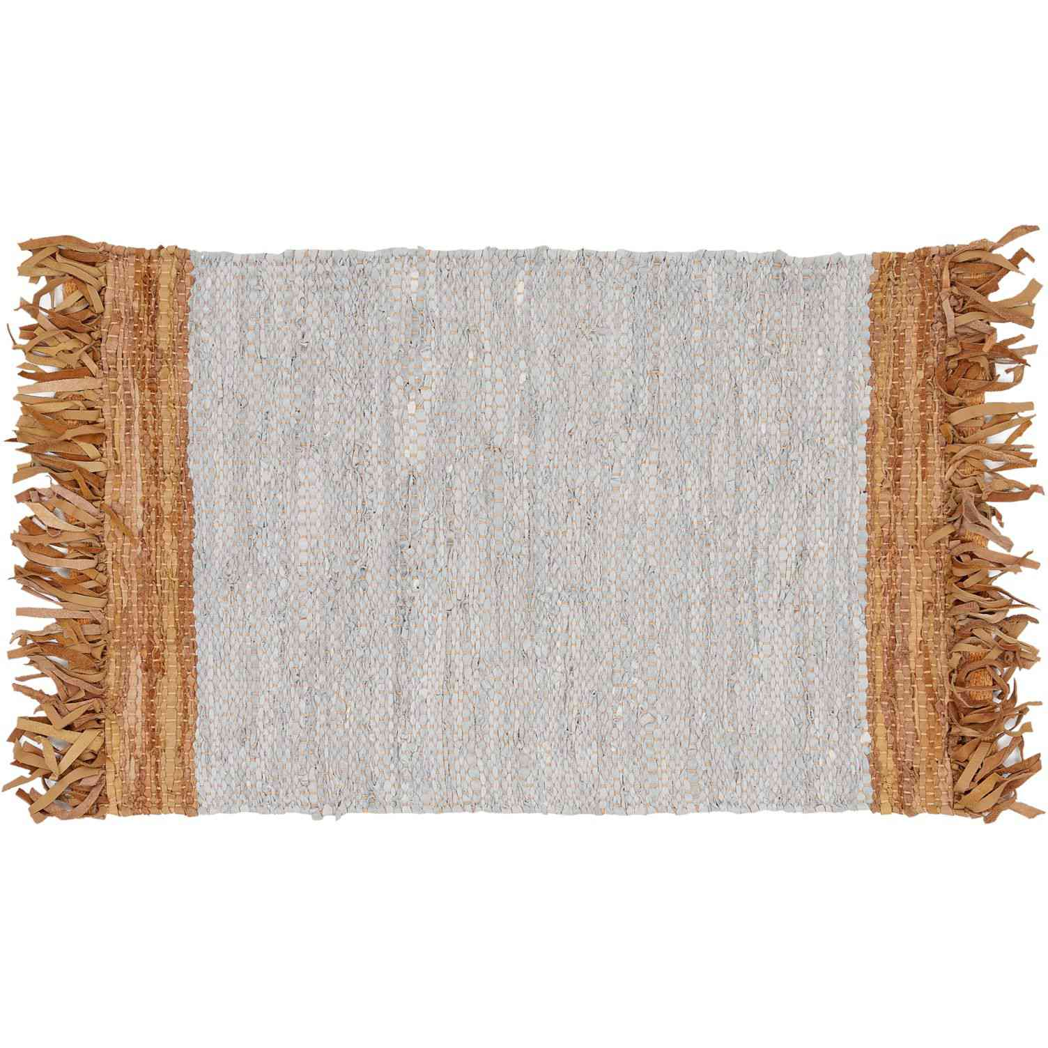 A fringed leather area rug.
