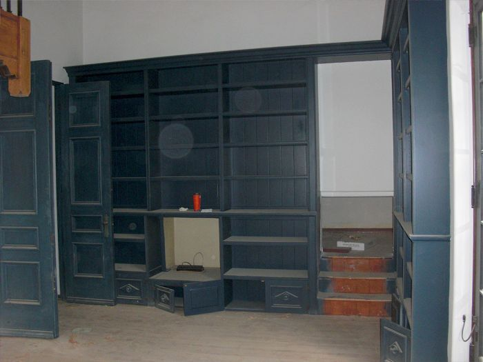 Before photo of built in shelving