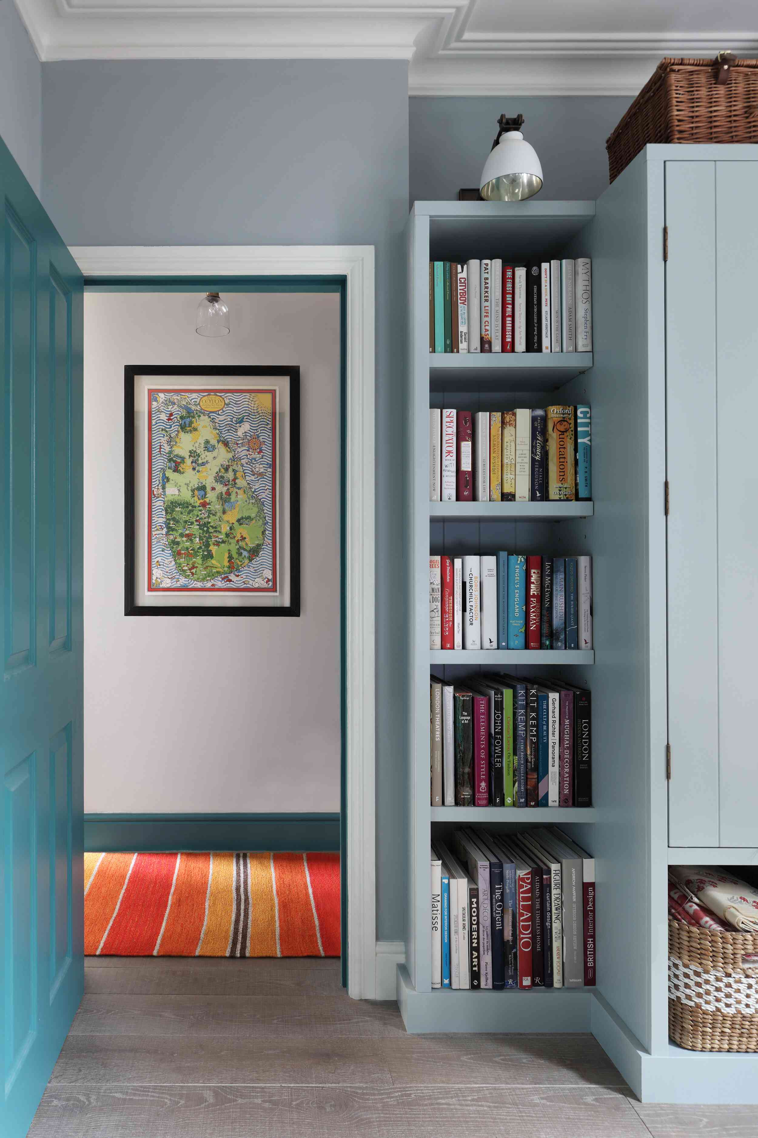 Blue painted room with built in vertical shelving