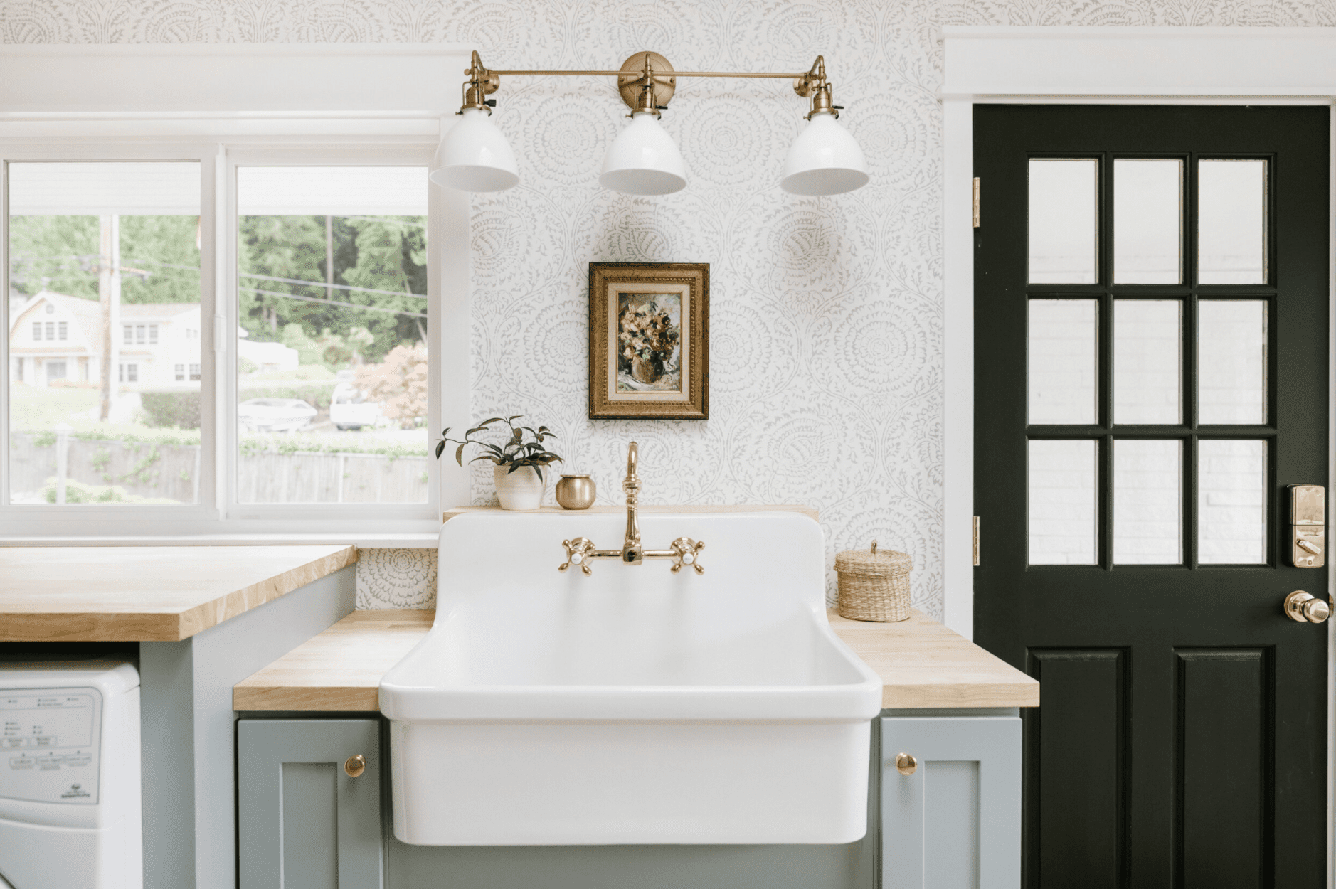 A farmhouse kitchen with faint wallpaper lining the walls